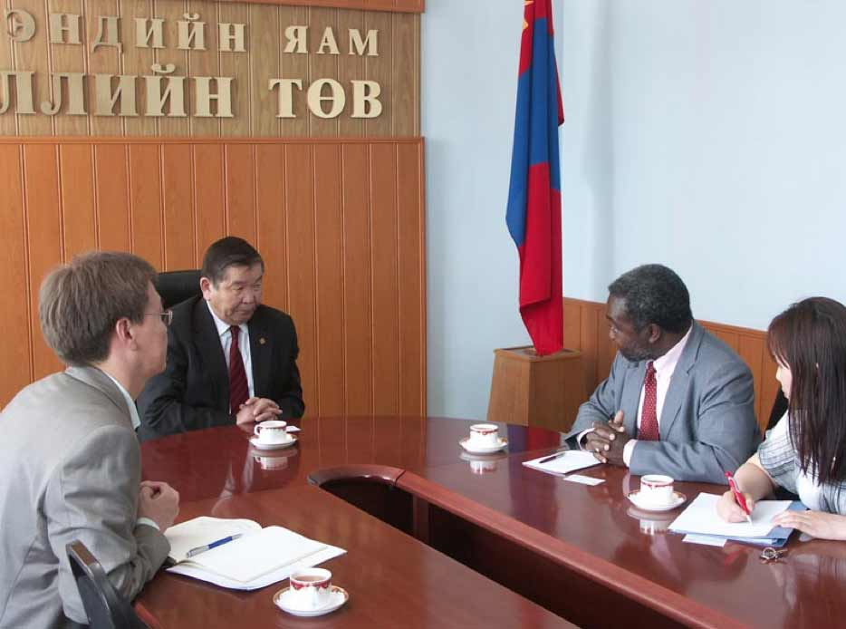 Prof. Kwankam in a client meeting with the Mongolian Minister of Health, the Director of Department of Information Monitoring and Evaluation (DIME) of the MoH and an official of the DIME.